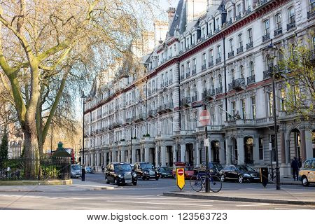 LONDON UK - April 14, 2015: London street of typical small 19th century Victorian terraced houses UK