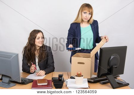 Office Staff Member With A Smile Watching Charges Fired Colleagues