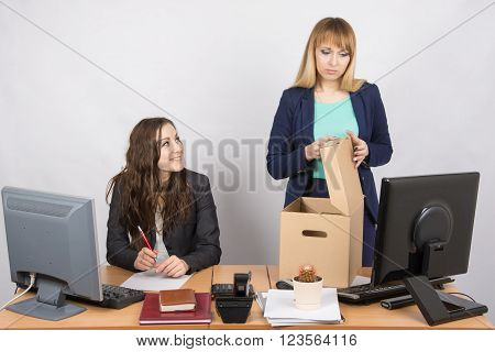 Office Staff Member With A Smile Watching Fired Colleague