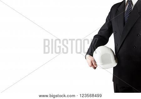 Close up of engineer hand holding white safety helmet for workers security isolated on white background.