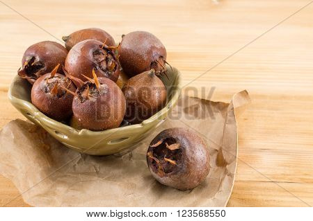Medlars On An Old Wooden Table