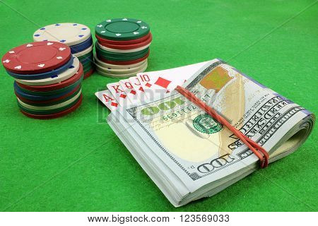 Money Royal Flush fnd chips in background cloth