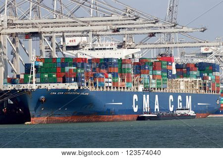 ROTTERDAM NETHERLANDS - MAR 16 2016: Container ship Christophe Colomb from CMA CGM moored at a container terminal in the Port of Rotterdam.