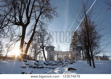 Colonnade of Apollo in Pavlovsk Park at sunset. Sanctuary of the Greek God of the sun and patron of arts. Historic architecture. Landscape Park Museum in Pavlovsk, Saint Petersburg.  Apollo Belvedere.