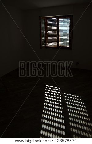 sunlight on the floor in an empty dark room