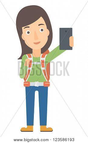 Backpckaer making selfie.