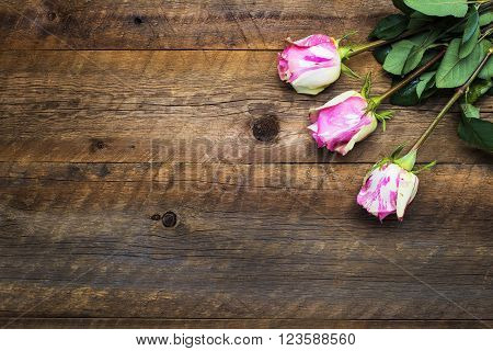 flowers lying on an old wooden board for the background and design space holiday