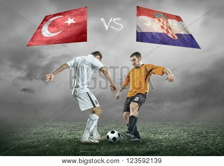 Football player on soccer field of stadium. Match between two national teams.
