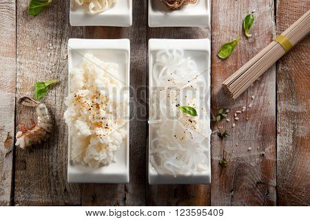 Various Noodles and Garnish on Wooden Background
