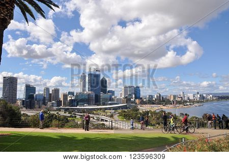 PERTH,WA,AUSTRALIA-AUGUST 22,2015: Elevated view from King's Park of the cityscape, roadways, Swan River and tourists in Perth, Western Australia.