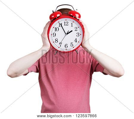 Man in a pink shirt with a red alarm clock