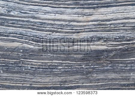 Closeup abstract background texture photo of blue white marble stone with natural limestone pattern and cracks