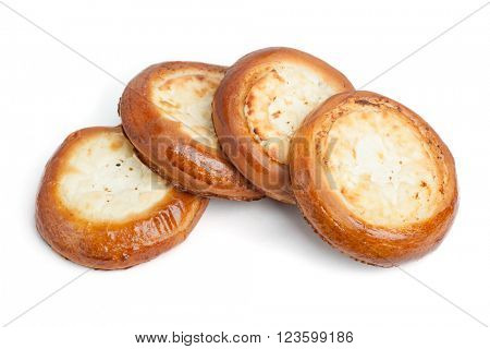 Traditional russian baking: round buns with cottage cheese (vatrushka) isolated on white background