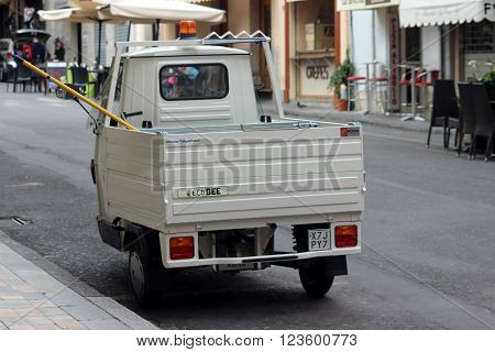 San Remo Italy - March 20 2016: White Piaggio APE 50 Van Parked in the Streets of San Remo. City on the Mediterranean Coast of western Liguria in north-western Italy