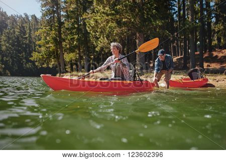 Mature Couple Having Fun Kayaking In The Lake