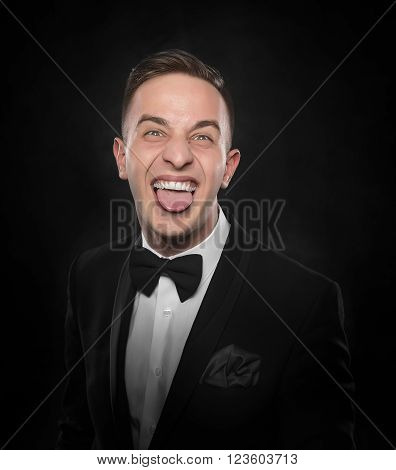 Businessman in suit shows tongue. Negative human emotion over dark background.