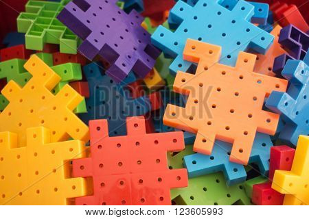 Colorful plastic jigsaw puzzle game, stock photo