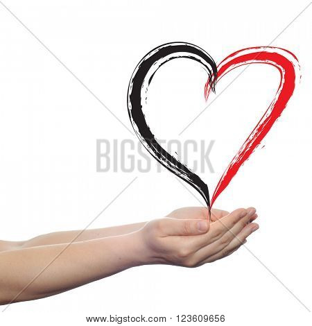 Concept or conceptual painted red heart shape love symbol made by happy child at school, held in human man or woman hand isolated on background
