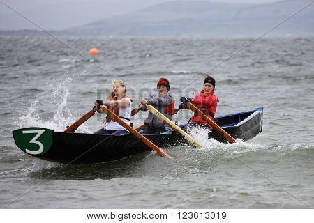 GALWAY - MAY 26: Unidentified athletes compete in All Ireland Currach Racing during traditional annual An Tóstal Festival on May 26 2013 in Galway Ireland.