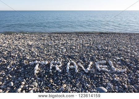 The Sign Travel Made From White Pebbles On Pebble Beach On The Sea