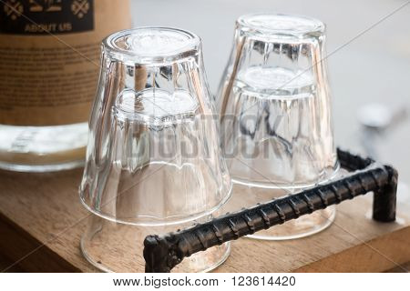 Clean glass in wooden tray stock photo