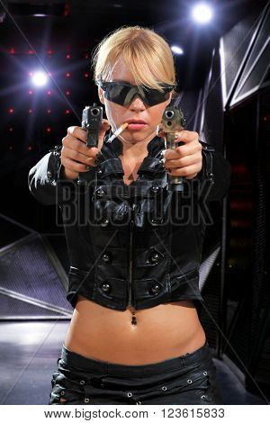 beautiful sexy blonde girl holding gun