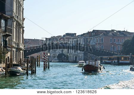 Venice Italy - Febuary 19 2016: Ponte dell'Accademia in Venice a city resignated as a World Heritage site in italy. It is famous for the beauty of its settings archtecture and artwork.