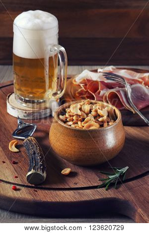 Unfiltered beer, nuts and  cold cuts. Toned image