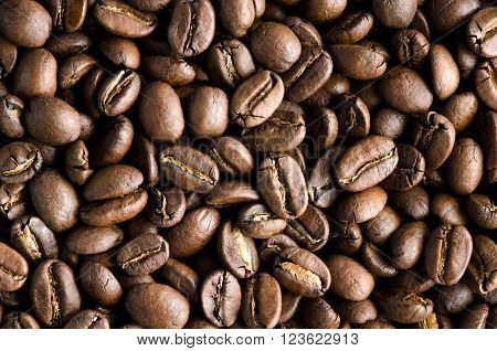 Texture of tasty rich and fullbody roasted coffee beans.
