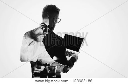 Double exposure young bearded  banker wearing black shirt and holding contemporary notebook hands.Blank screen ready for you message.Isolated white, portrait man background.