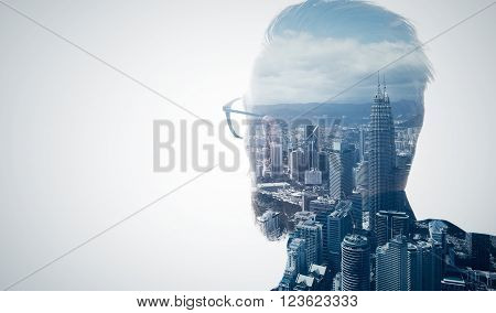 Photo of stylish bearded lawyer wearing trendy suit and looking city. Double exposure, panoramic view contemporary megalopolis background. Space for your business message.  Isolated white.