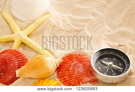 Compass, Seastar And Seashells In Sand