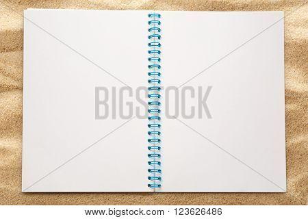 Blank Open Notepad On Sand