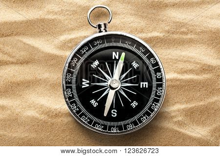 Black Compass On The Sand