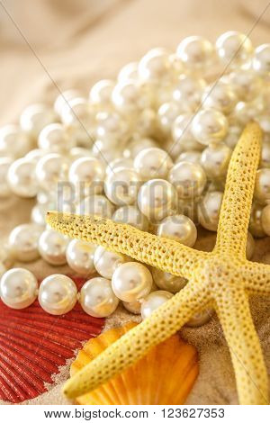White Pearl And Seashells On Sand