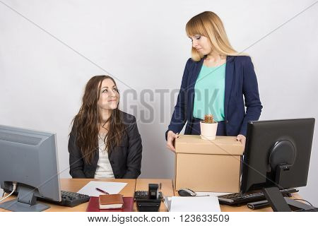 Office Worker With A Smile Looking At The Dismissed Colleague