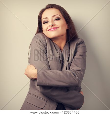 Enjoying Business Woman Hugging Herself With Natural Emotional Face. Love Concept Of Yourself. Toned