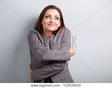 Happy Business Woman Hugging Herself With Natural Emotional Enjoying Face And Thinking Look. Love Co
