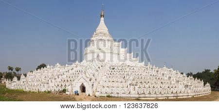 Beautiful white Hsinbyume Pagoda in Mingun. Panoramic photo. Western bank of Irrawaddy river, Myanmar