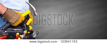 Builder handyman with a hammer.