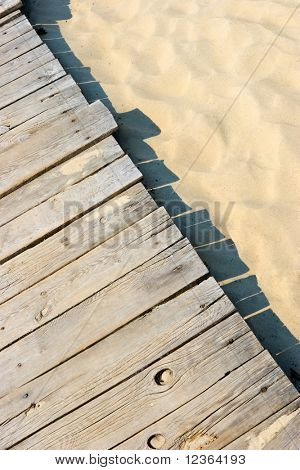 Weathered wooden boardwalk on sand dune at Couronian lagoon