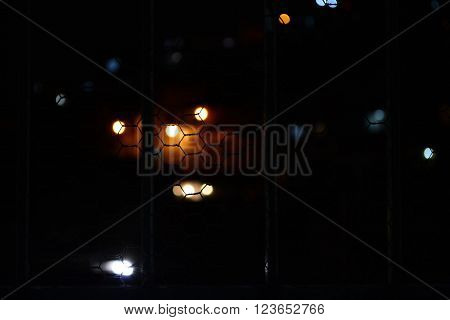 the city lights in blur behind bars