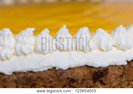 Advocaat cake on white wood macro. background