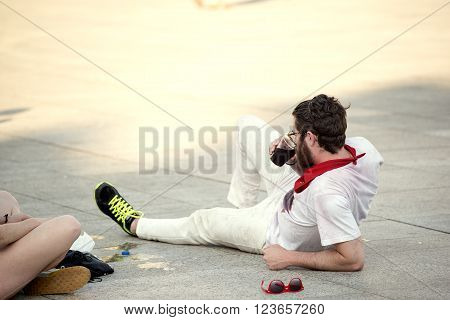 Spain Navarra Pamplona 10 July 2015 S Firmino fiesta a boy lying on the sidewalk during the festival, for s Firmino they consume large quantity of alcohol in happiness