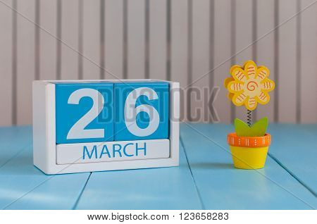 March 26th. Image of march 26 wooden color calendar on white background whith flower.  Spring day, empty space for text. Purple DAy is the international day For epilepsy awareness