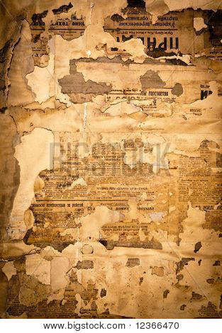 Grungy background with old yellowed Soviet newspaper fragments