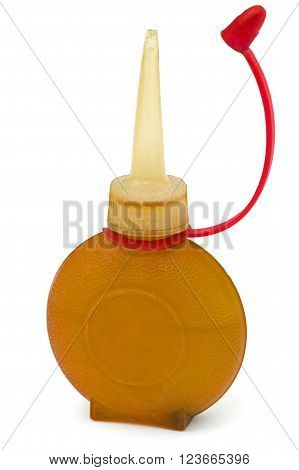 Old bottle of lubricating machine oil isolated on white background