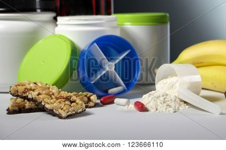 Sport Nutrition Supplement containers with pills