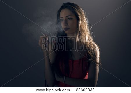 Beautiful Young Woman With A Cigarrette.