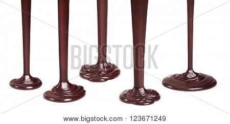 Flowing dark chocolate isolated on white background